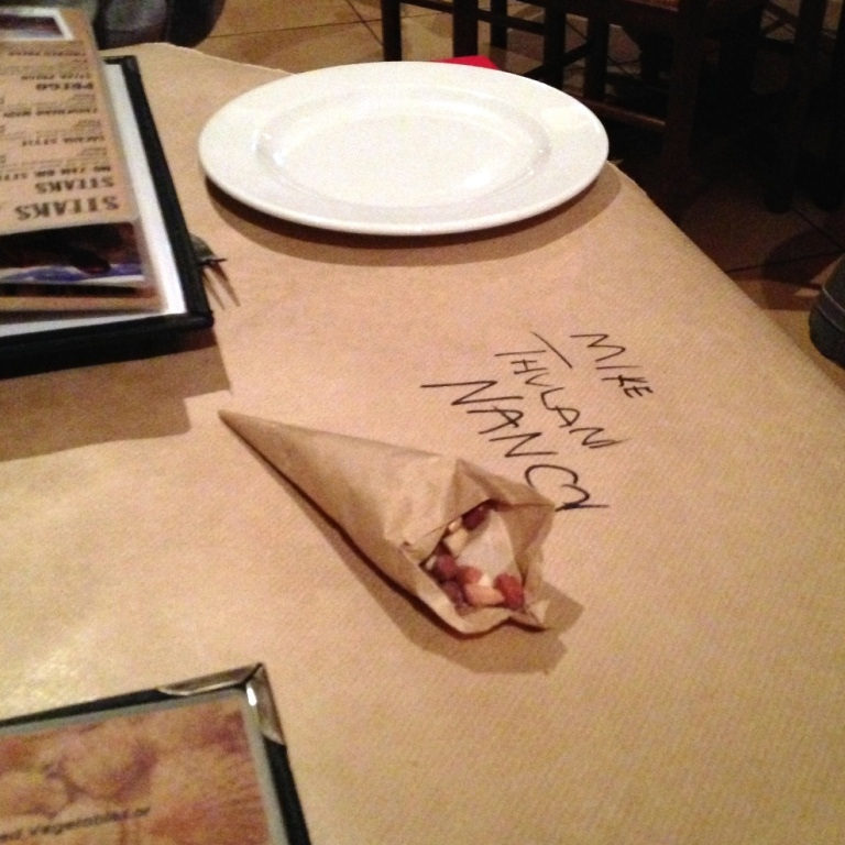 Waiters write their names on the table cloth, upside down